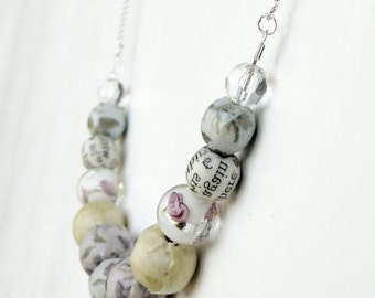 Pastel blue, yellow, and lilac beaded necklace, fabric and paper covered beads