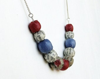Red, blue, and floral beaded necklace, fabric covered beads