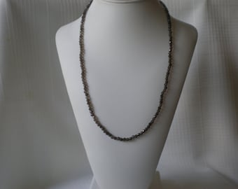 Smoky quartz necklace made with faceted round gemstone beads present for someone special