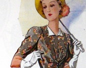 1930s dress pattern. Accented shoulders and gathered waist.