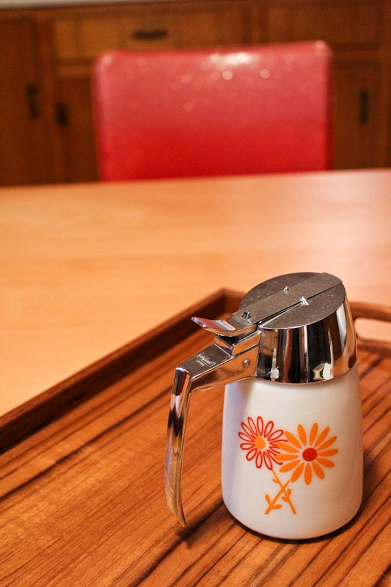 red and orange daisy creamer : syrup dispenser