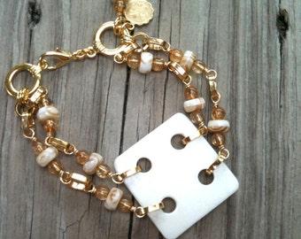 Cream Bracelet - Fleur de Lis Charm - Gold Jewellery - Double Strand Jewellery - Square - Modern - Avant Garde - Funky B-66