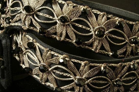 Black belt, silver embroidery, jet beads.