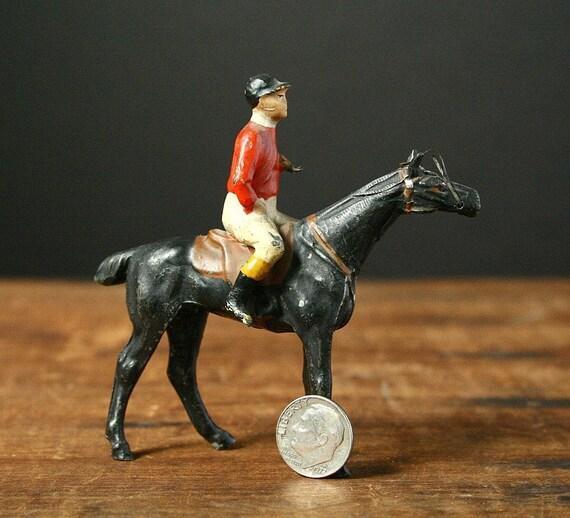 Jockey on a horse, cast iron figurine