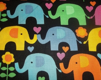 Timeless treasures Multi Colored Elephants on black back ground with hearts and flowers 1 yard cotton quilt fabric