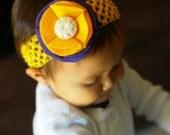 LSU Felt flower headband. purple and gold blossom with cream crochet button.