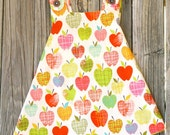 Apples criss cross dress with bloomers. 2T