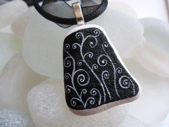 White swirls on ebony sea pottery necklace - black ribbon and cord - hand painted