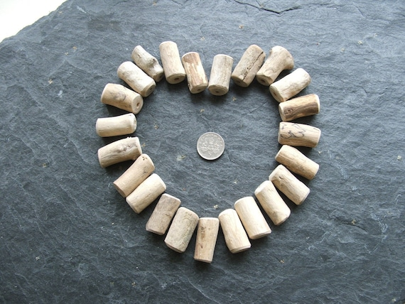 23 Natural Driftwood Tube Beads. Centre drilled with 3mm holes