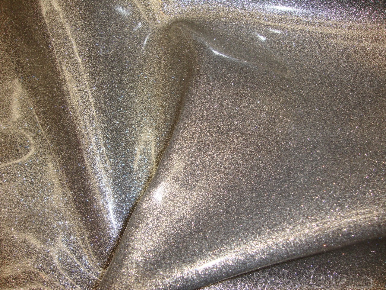 Orion silver glitter vinyl upholstery fabric by for Sparkly material