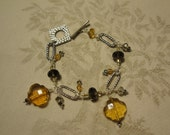 Moroccan inspired Smoky Quartz, Crystal and Glass Charm Bracelet with Silver and Pewter