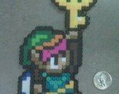 Link holding the Big Boss Key from Zelda: A Link to the Past Magnet SNES pixelated character