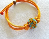 "Lampwork bracelet with chinese knotting "" Orange- blue passion """