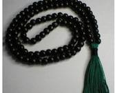 Black wooden bead Buddhist Mala w green tassel