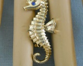 Little Vintage Seahorse Pin with a Blue Rhinestone Eye