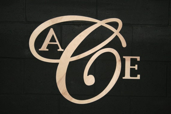 Large Center Letter with Initials, Monogram, Script Style