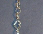Open heart  silvertone chain bracelet