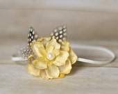 Silk Yellow Flower adorned with pearls and quail feathers on a skinny elastic headband