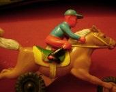 Jockey on Race Horse, bobbing gait, 1960s hard plastic and tin friction toy, slightly shabby but works like a charm