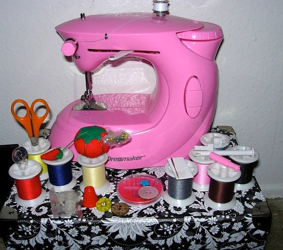 Miniature Pink Portable Sewing Machine, 35 Pre Wound Bobbins, other extras, Dressmaker 997H by Euro Pro battery operated