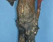 Tall man bronze sculpture