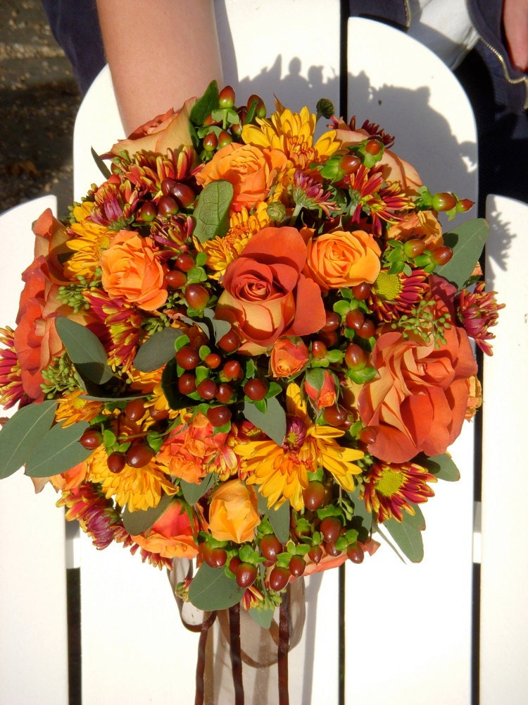 Fall wedding bouquet made of silk flowers.