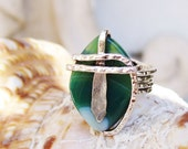 Wire wrapped Ring - Framed emerald colored Murano glass