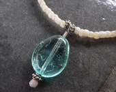Cream Glass Beaded Necklace with Silver Accents and Bright Aqua Blue Pendant