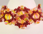 Bead Woven Bracelet in Red Yellow and Orange Tones