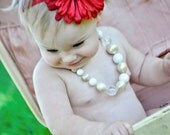 A Vibrant Deep Red Flower Headband With a Vintage Rhinestone Center.