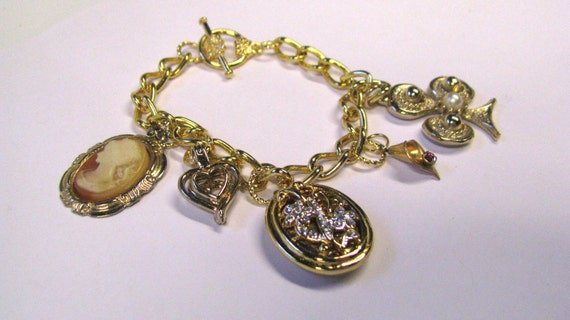 OOAK Charm bracelet made with vintage jewelry bits and bobs-Gold tone