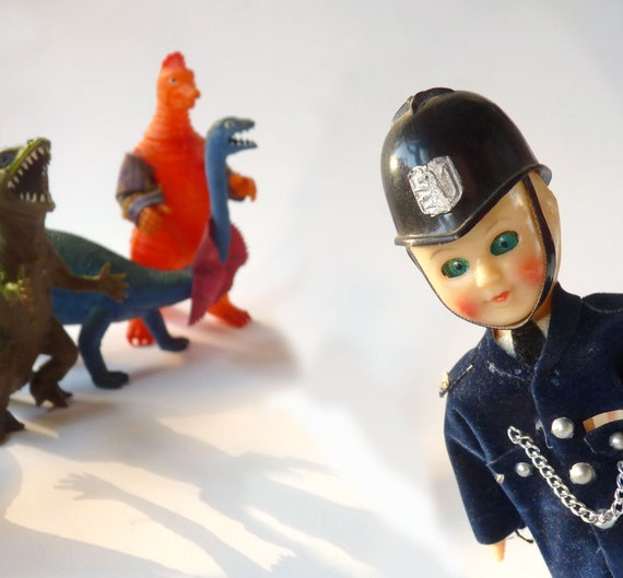 British Bobby Doll, celluloid constable sleepy eye with helmet, Wot's all this, then