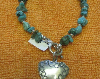 Turquoise bracelet with heart charm