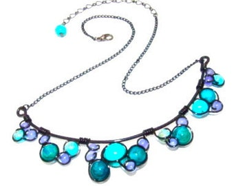 Wire wrapped necklace with turquoise, azurite chrysocolla and jade stone beads, black craft wire and adjustable chain.