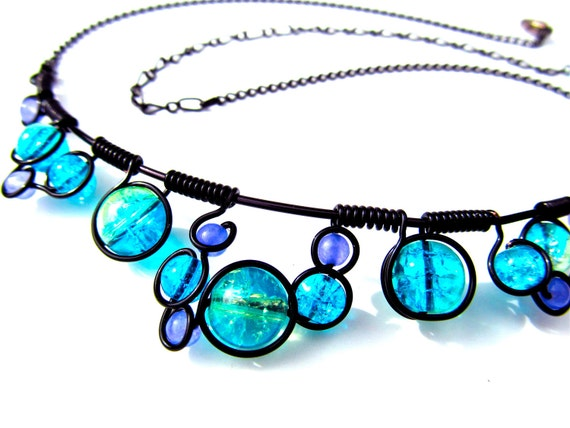 Wire wrapped necklace with blue and purpe crackle glass beads, black wire and adjustable chain