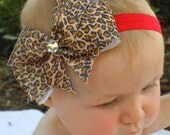 LEOPARD Hair Bow with Rhinestone Center on a Red Elastic Headband