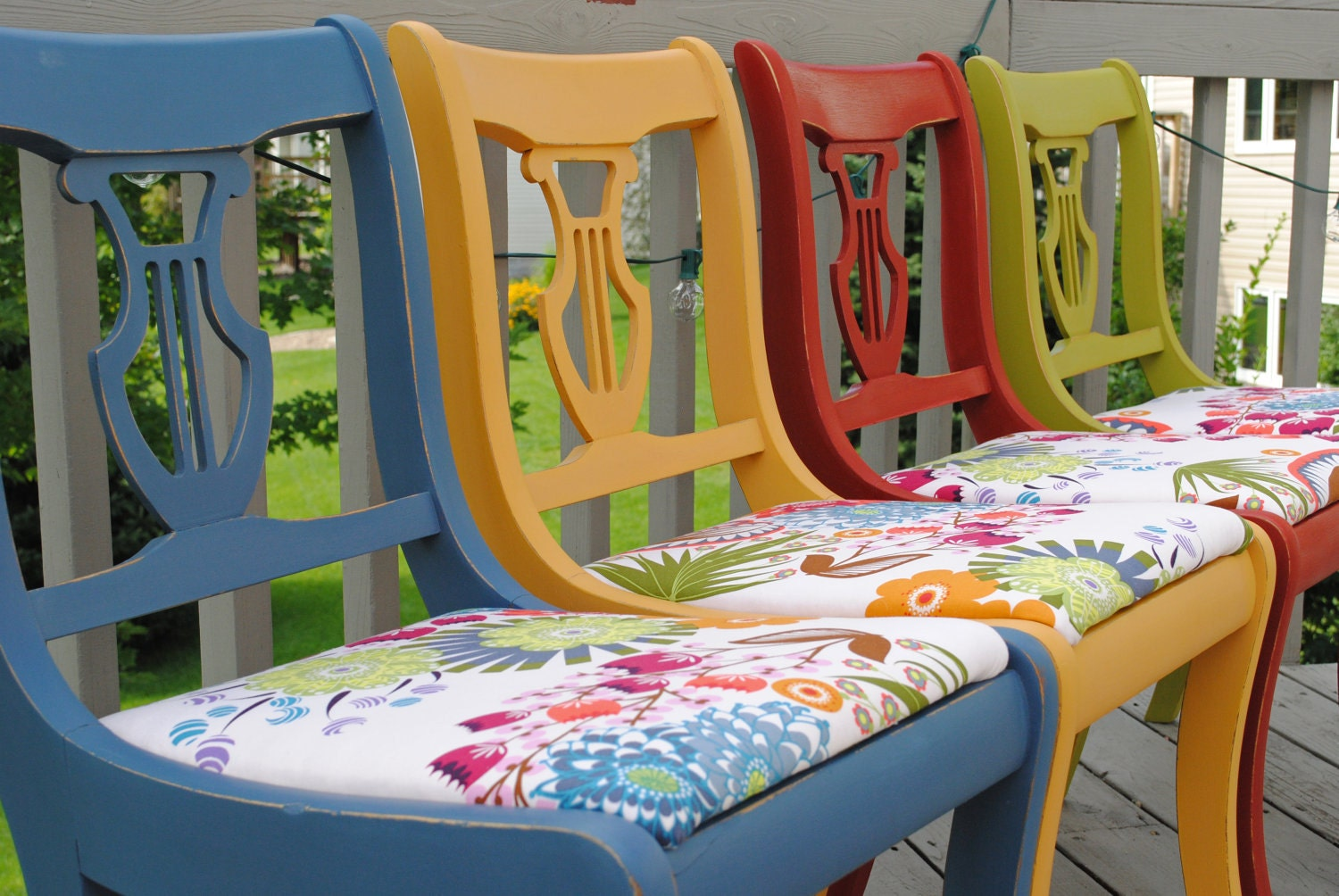 reserved set of four colorful dining chairs