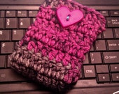 Pink and black phone cozy