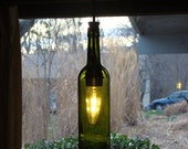 Anns three wine bottle light