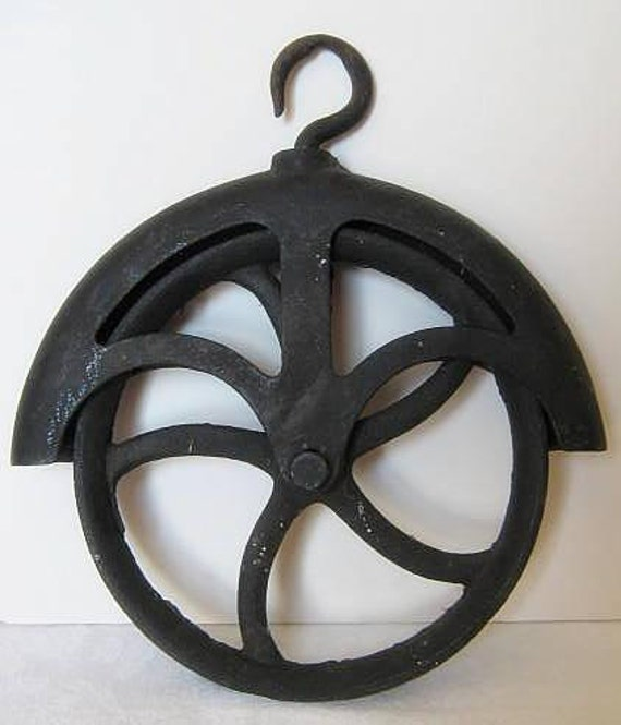 Vintage cast iron steam punk pulley industrial farm loft for Uses for old pulleys