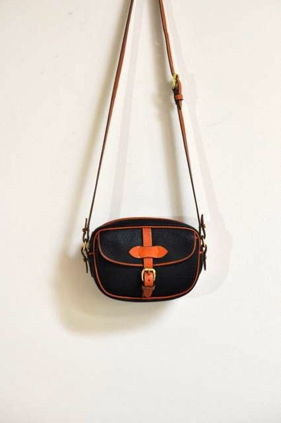 Vintage Dooney & Bourke Black and British Tan Small Round Crossbody Buckle Bag