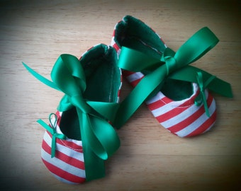 Red and white striped christmas shoes