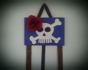 purple skull with flower bow holder