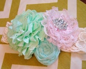 Mint Green, Auqa, and Light Pink vintage rosette headband on cream lace