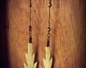 Hand cut arrowhead design earrings from cow hide with brass findings