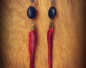 lava rock, red leather hand cut feathers, and  purple czech glass beads