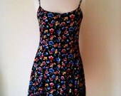 VINTAGE summer short dress. Black button through sun dress with all over red yellow blue floral print.