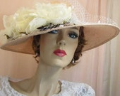 Pink and white large brimmed hat with Russian veiling