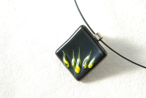 Fused glass necklace - black with yellow and glittering green fire tongues