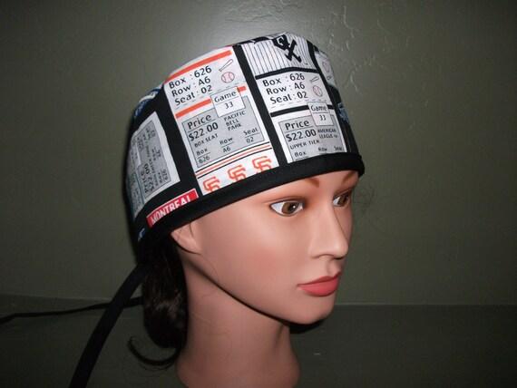 Male scrub cap with baseball tickets